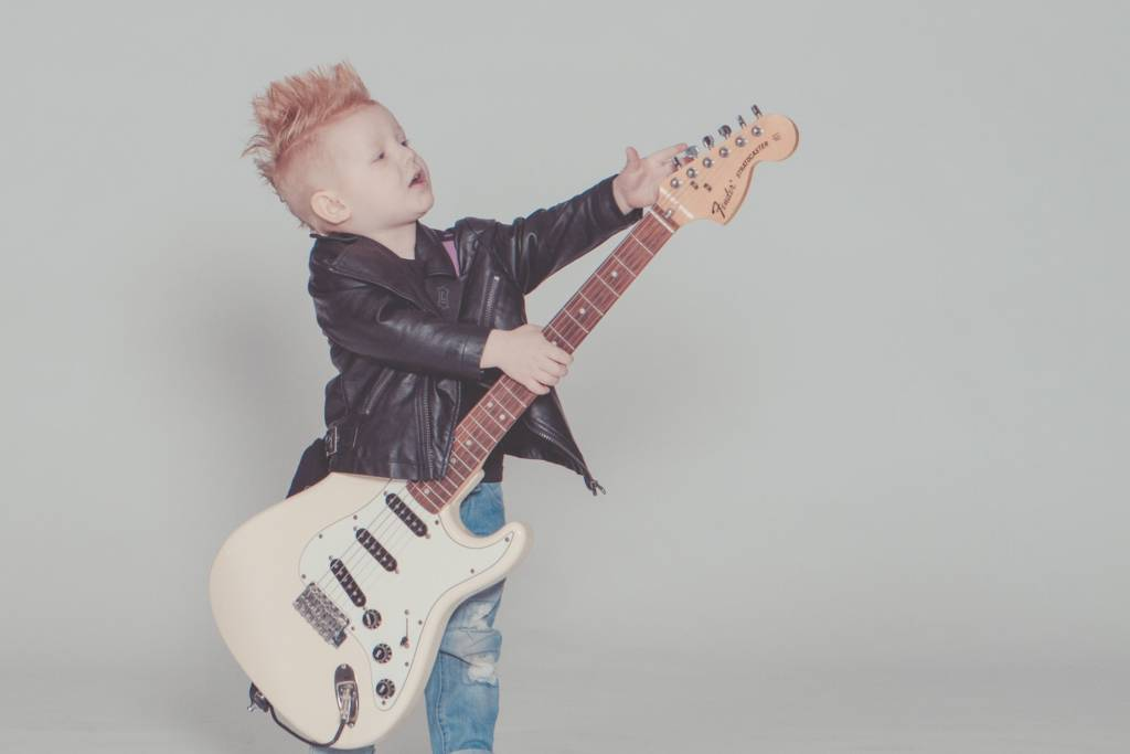 Boy about to play rock guitar Tampa Music School