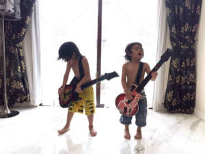 two-boys-playing-guitar