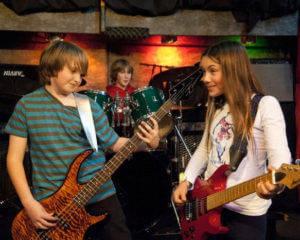 happy kids taking bass classes in Miami