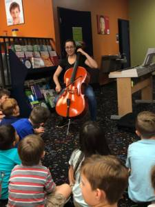 teacher leading cello classes in Miami