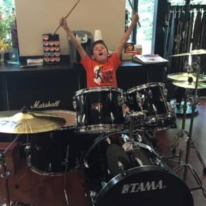 student taking drum classes in Miami