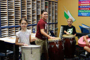 happy students taking drum lessons in Miami