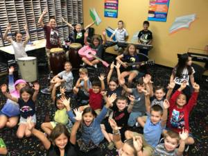 happy students taking music classes in Miami