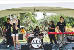 teachers performing from a music school in Miami
