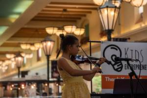 student performing for violin classes in Miami