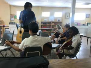 guitar classes in Miami - students taking an after school class at Hyde Park Montessori